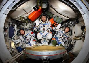 Inside view of the Shenzhou 7 re-entry capsule, with the commander seated in the middle